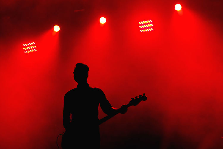 Color Palette Colour Of Life Festival Season Guitar Guitarist Illuminated Music Music Festival Musician Red Red Color Red Lights Rock N Roll Sillouette Stage Standing Unrecognizable Person