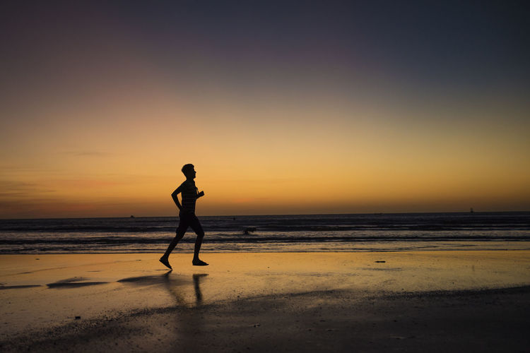 Beach Beauty In Nature Brazil Full Length Horizon Over Water Jericoacoara Leisure Activity Lifestyles Nature One Person Outdoors Running Sand Scenics Sea Shore Silhouette Sunset Tranquil Scene Tranquility Travel Destinations Water