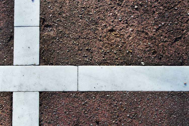 Directly Above View Of White Tiles On Road