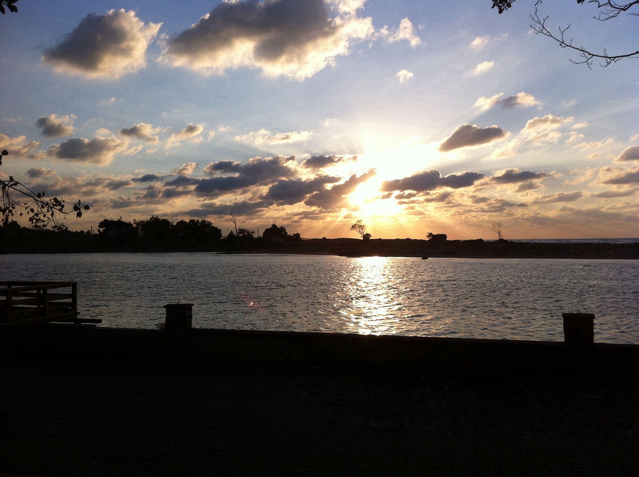sunset, water, sky, sun, tranquil scene, scenics, tranquility, beauty in nature, cloud - sky, silhouette, sea, reflection, nature, sunlight, lake, idyllic, cloud, orange color, pier, sunbeam