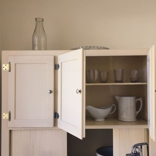 Kitchen utensils in cupboard