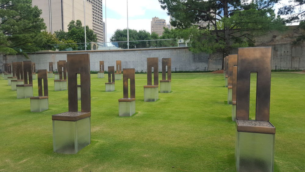 Murrah Building Memorial Oklahoma City Oklahoma Empty Chairs Broken Heart the smaller chairs represent the children killed in this bombing. 168 lives lost.