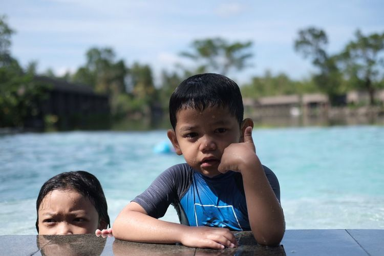 Two children in the swimming in pool