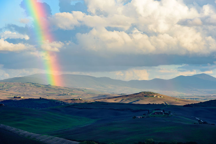 Rainbow in a tuscany landscape Beauty In Nature Cloud - Sky Cloudscape Cloudy Cumulus Cloud Day Geology Landscape Majestic Mountain Mountain Range Multi Colored Nature No People Non-urban Scene Outdoors Physical Geography Rainbow Remote Scenics Sky Sunbeam Tourism Tranquil Scene Tranquility
