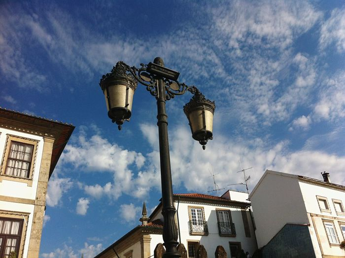 Low angle view of lamp post and built structures