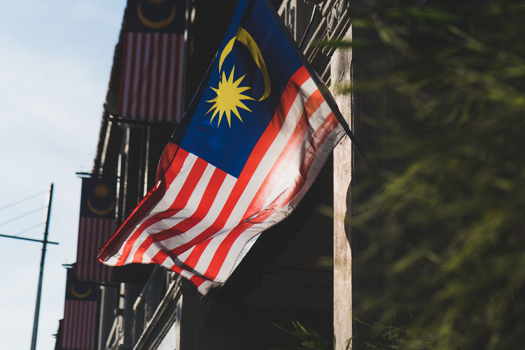 Low Angle View Of Malaysian Flag Against Sky