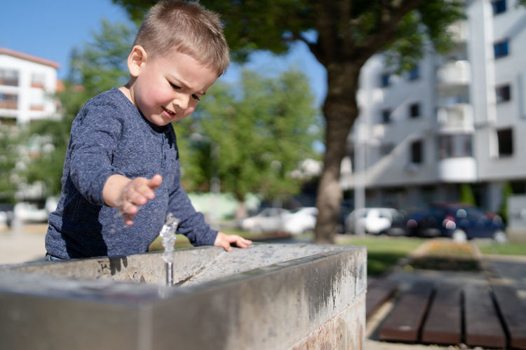 Childhood Child Boys Day Casual Clothing One Person Real People Men Males  Architecture Leisure Activity Built Structure Looking Building Exterior Lifestyles City Selective Focus Nature Outdoors Innocence