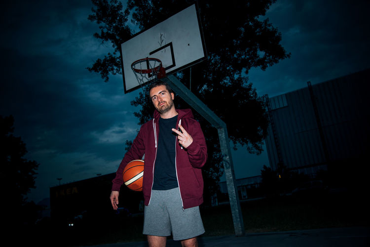 Basketball Basketball Player Casual Clothing Cloud Cloud - Sky Front View Guy Leisure Activity Lifestyles Man Outdoors Portrait Sky Standing
