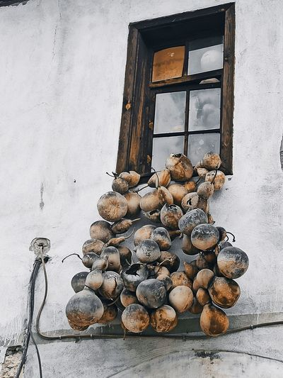 Stack of firewood on wooden wall
