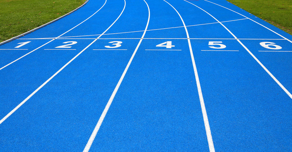 High Angle View Of Numbers On Blue Running Track