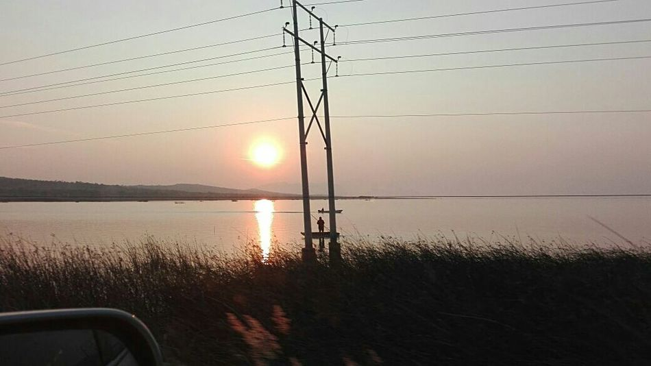 Power Line  Sunset Nature Tranquility Power Supply Lake Electricity Pylon Silhouette Cable Water Electricity  Sky Outdoors No People Reflection Beauty In Nature Scenics Tree Day