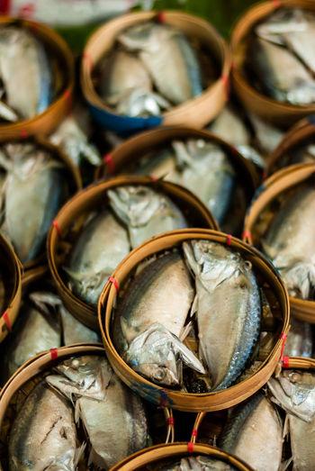 Full frame shot of fishes in baskets at market for sale