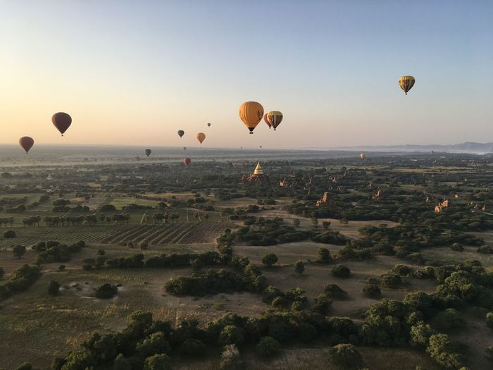 View of hot air balloons flying in city