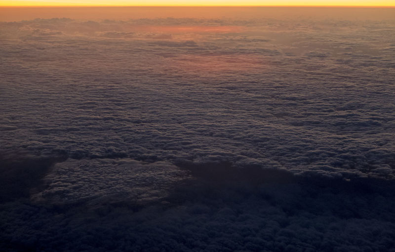 High angle view of sea against sunset sky
