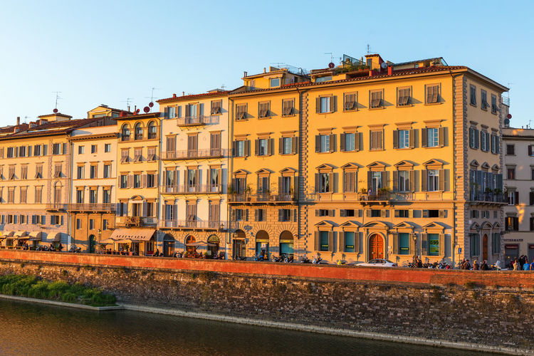 Building facades in the evening light House River Building Exterior Building Built Structure Architecture Sky City Residential District Clear Sky Outdoors Street Townhouse Sunset Town Florence Italy Arno  Arno River Urban Evening Light View Houses Water Old Cityscape Scenery Scene Facades Residential Building Sunrise Residential Area