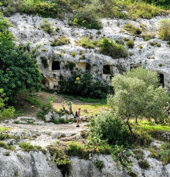 a spasso per la necropoli NecropolidiPantalica Rock Formation Trekking Nature Love Tree Architecture Grass Building Exterior Built Structure Plant Life