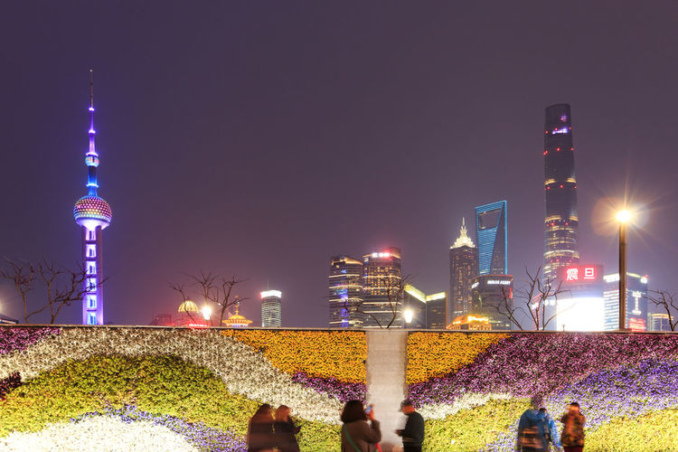 People Against Illuminated Skyscrapers