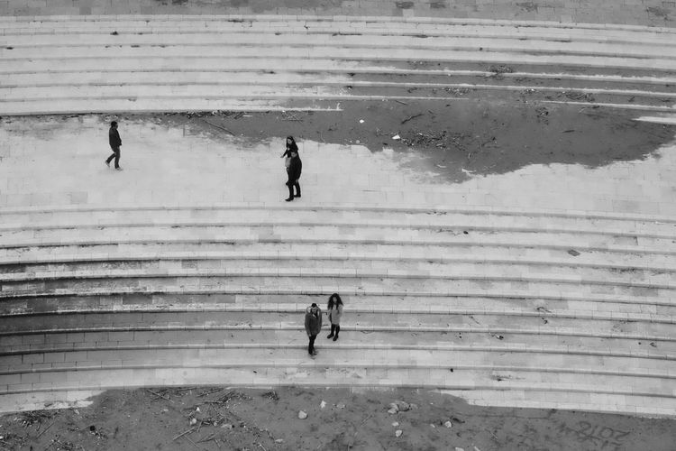 High angle view of people on steps