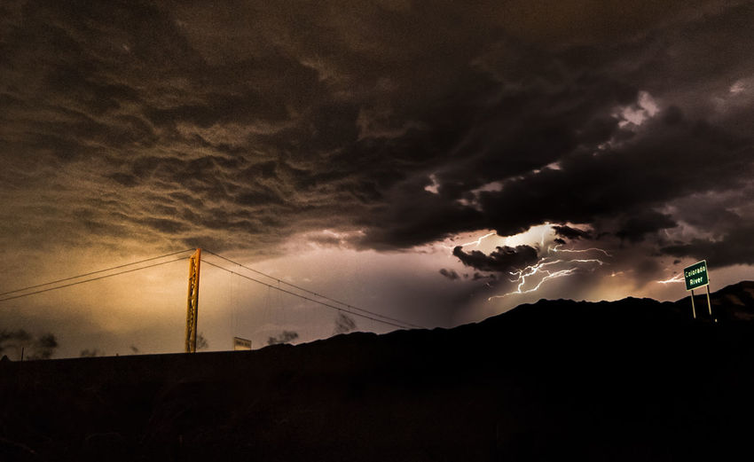 Lightning Storm & Bridge Over the Colorado River. Cloud - Sky Sky Silhouette Storm Nature Dramatic Sky Storm Cloud Lightning Storm Lightning Bolt Stormy Weather Colorado River Bridge Highway Blm Night Photography Ominous Power Outdoors Scenics - Nature Travel Destinations Road Tree