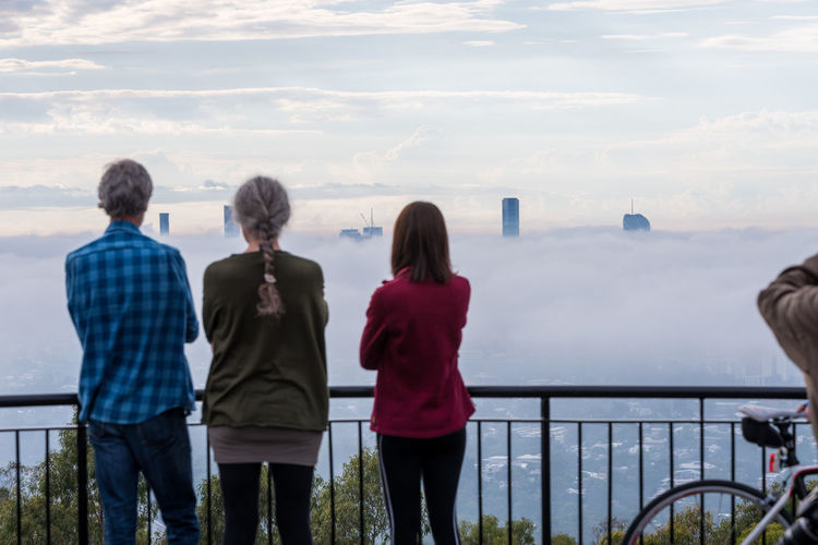 Foggy morning Rear View Group Of People Sky Water Three Quarter Length Railing Standing Men Women Cloud - Sky Nature Adult Real People Sea Lifestyles Leisure Activity Casual Clothing People Scenics - Nature Outdoors Looking At View