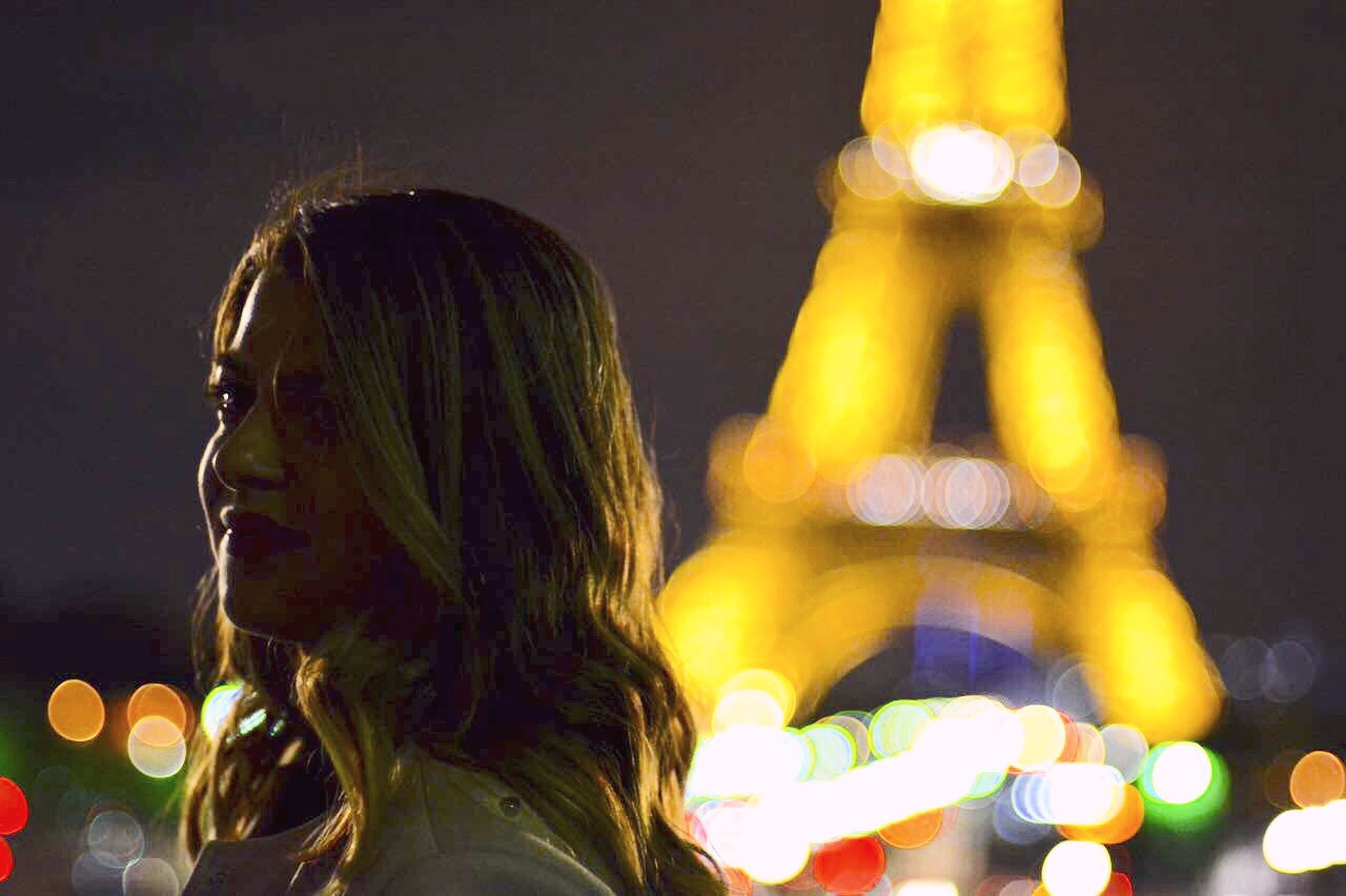 night, long hair, one person, illuminated, one woman only, side view, young adult, adult, only women, headshot, people, adults only, one young woman only, young women, outdoors, city, close-up