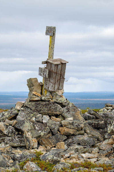 Rickety old mailbox on top of fell Jorpulipää in the Tankavaara area of Finnish Lapland contains a visitors' book for hikers. Autumn Lapland, Finland Travel Adventure Arctic Beauty In Nature Cloud - Sky Day Distant Horizon Fell Landscape Mailbox Nature No People Outdoors Pile Of Stones Remote Locaton Rock - Object Rusty Wire Scenics Sky Summit Tranquility Wooden Post