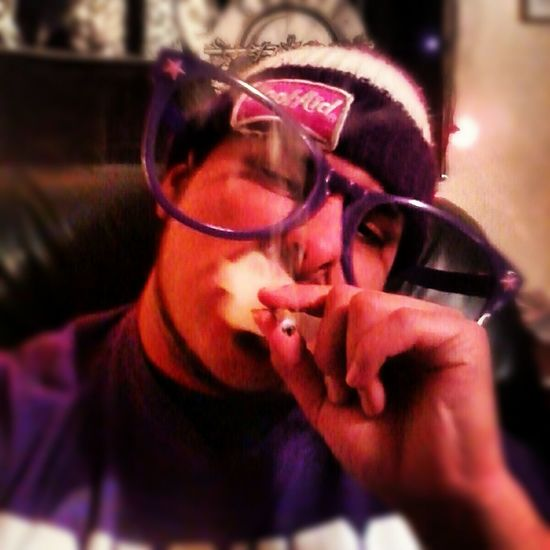Blunts Confidence  Front View Head And Shoulders Holding Koolaid Lifestyles Looking At Camera Person Portrait Purps Real People Serious Stunna Shades!¡! Thizzlatin ThizzNation Young Adult