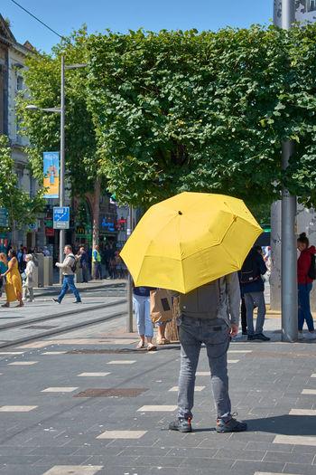 People walking on road in rain