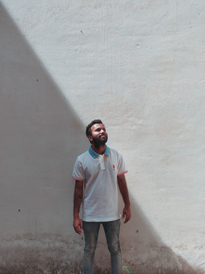 Men Portrait Standing Beard Front View Young Men Depression - Sadness Three Quarter Length Sand Casual Clothing Cement Concrete Block Grief Concrete Wall Abandoned Deterioration Grunge Loss Teardrop Despair Mourning Grave Crying Plaster Smudged Distressed Run-down Bad Condition Hopelessness 17.62°