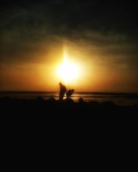 Sea Water Horizon Over Water Sunset Nature Beach Scenics Silhouette Tranquility Beauty In Nature Idyllic Sun Sky Real People Tranquil Scene Outdoors Two People Men People Only Men