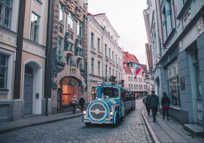 Old Town of Tallinn Estonia Old Town Tallinn Architecture Building Exterior Built Structure City Day Men Outdoors People Real People Sky Street Train's Window Vintage Women