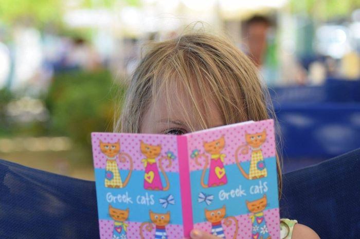 My granddaughter didn't want her photo taken Children Child Reading Peekaboo Summer Holidays Poros Cephalonia Colour Of Life, Resist