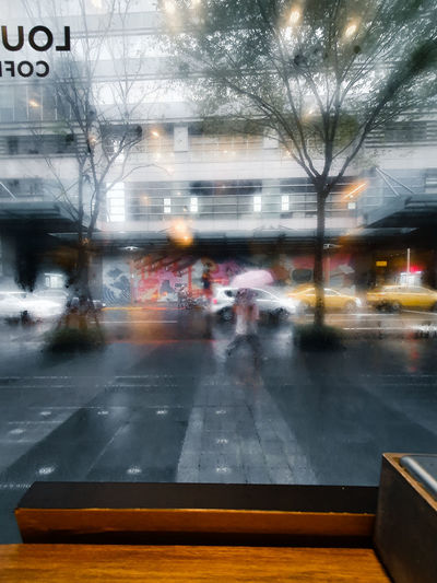 Blurred motion of car on road in rainy season