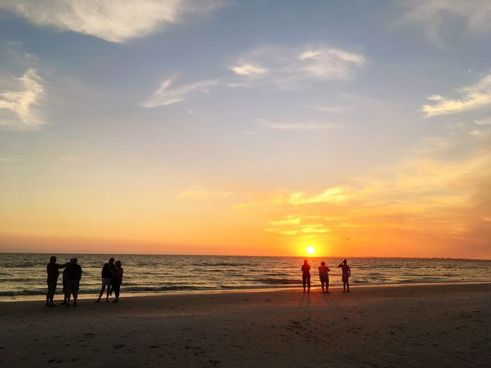 Beach Sea Sunset Sand Sky Shore Horizon Over Water Nature Water Cloud - Sky Beauty In Nature Scenics Silhouette Real People Lifestyles Vacations Leisure Activity Sun Enjoyment Outdoors Travel Destinations Ocean Breathing Space