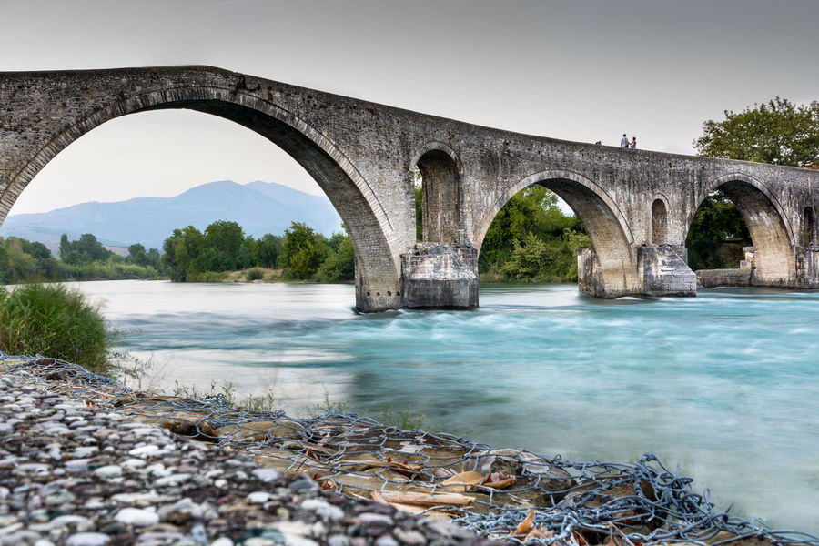 Arta's Bridge Architecture Artà Couple Love Riverside Sightseeing Arch Arch Bridge Architecture Arta Bridge Beauty In Nature Bridge Bridge - Man Made Structure Built Structure Connection Day Daylight Greece Haunted Long Exposure Outdoors River Rocks Travel Destinations Water
