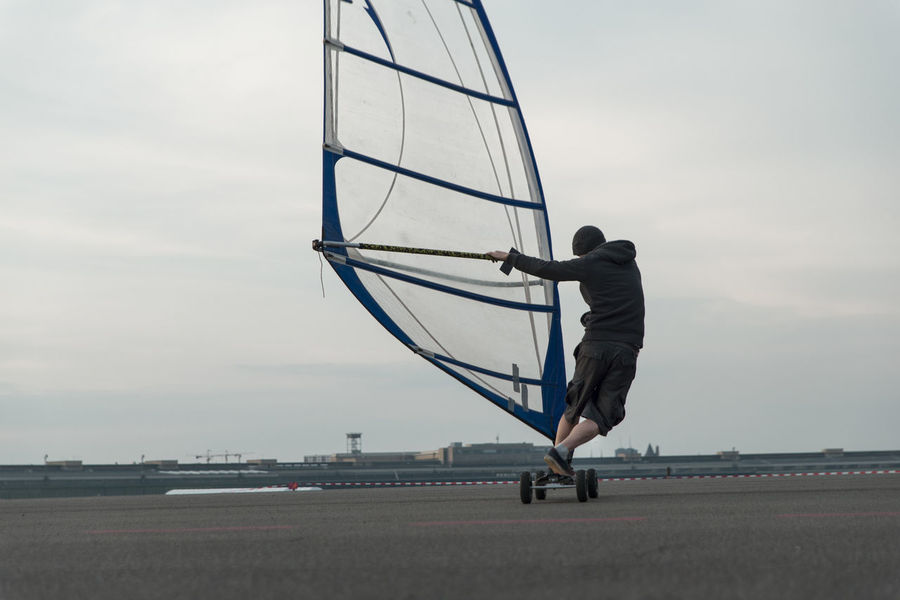 Airport Airstrip Berlin Kiteboarding Landing Landing Strip Man Negative Space Roll Rolling Runway Sail Skateboard Skateboarder Skateboarding Sky Sport Tempelhof Tempelhofer Feld Wind Windskateboard Windskating Windsurfing The Mix Up People And Places Discover Berlin
