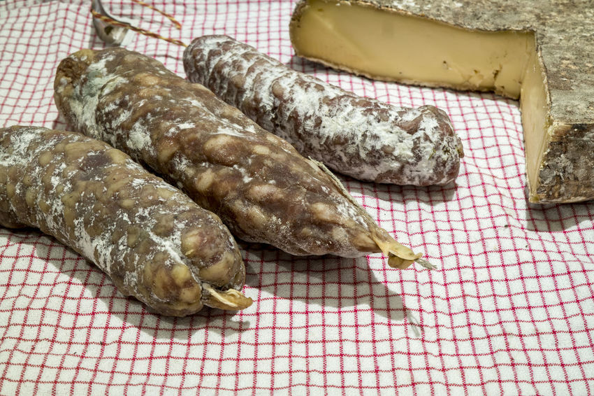 French cheese and saucissons Authentic Auvergne Cheese Food France Saint Nectaire Saint-nectaire Saucisson  Sausages Terroir