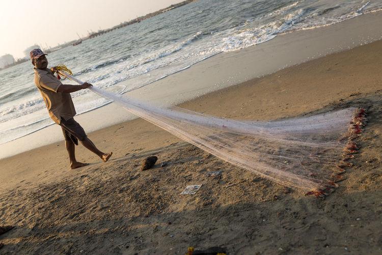 Man fishing on beach
