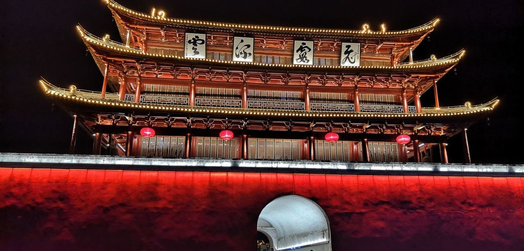 Red Illuminated No People Lighting Equipment Built Structure Architecture Religion Night Place Of Worship Low Angle View Building Building Exterior Decoration Pattern Ornate