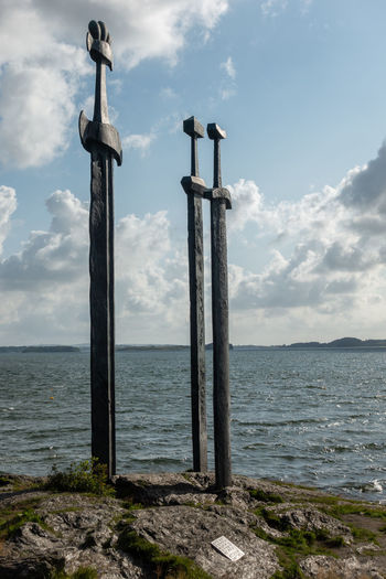Swords in the rock, monument in Stavanger, Norway. Norway Rock Stavanger Swords Swords In Rock Beach Beauty In Nature Cloud - Sky Day Fjord Horizon Horizon Over Water Land Monument Nature No People Non-urban Scene Outdoors Pole Post Scenics - Nature Sea Sky Sword Tranquil Scene Tranquility Water Wooden Post