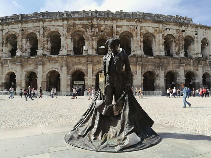 Travel Destinations History Tourism Ancient Architecture Travel Large Group Of People The Past Old Ruin Statue Monument Built Structure Sculpture Vacations Outdoors Architectural Column Real People Week On Eyem Weekend Ancient Civilization Adult People Nîmes