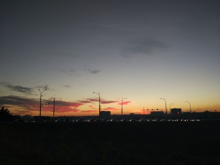 Sky Sunset Silhouette Cloud - Sky Beauty In Nature Environment Nature No People Orange Color Technology Landscape Scenics - Nature Fuel And Power Generation Tranquil Scene Outdoors Electricity  Tranquility Environmental Conservation Field Environmental Issues Dark Power Supply Pollution