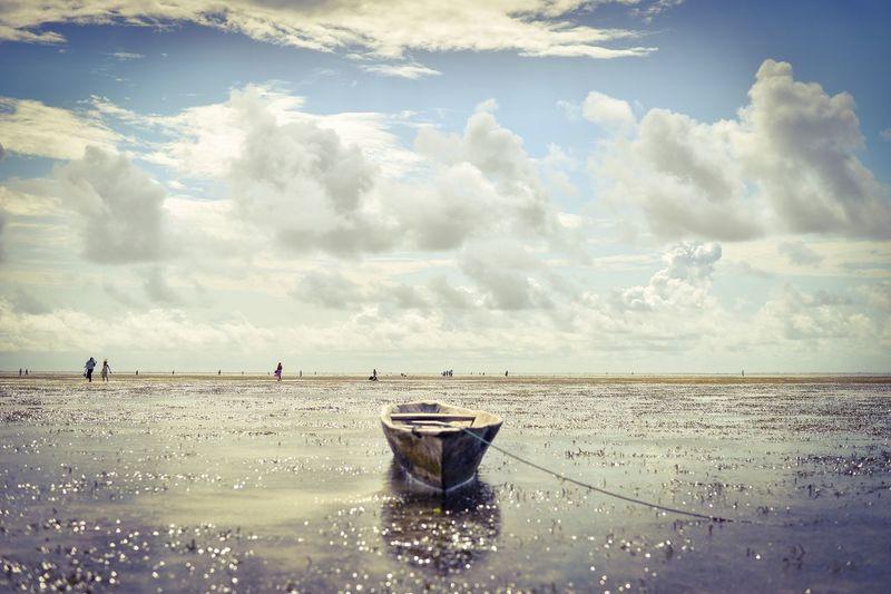 Boat Moored On Shore At Beach Against Sky At Zanzibar