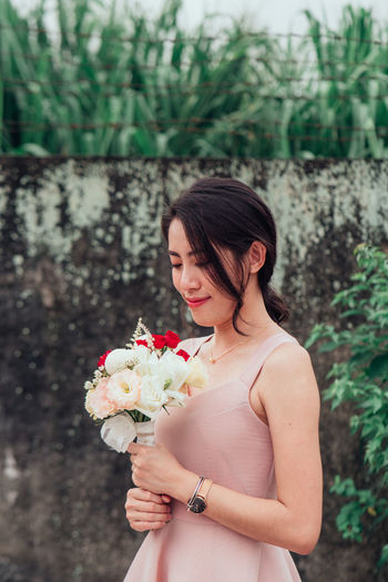 Flower Flowering Plant Plant One Person Young Adult Nature Standing Young Women Real People Focus On Foreground Lifestyles Beauty In Nature Women Adult Holding Leisure Activity Waist Up Vulnerability  Beautiful Woman Fragility Bouquet Hairstyle Flower Arrangement Outdoors Flower Head