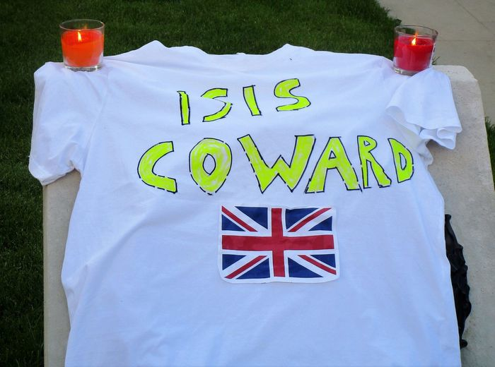 Evening vigil for the victims of the terrorist attack in Manchester. Albert Square Close-up Isis Manchester UK No People Outdoors Patriotism T Shirt T Shirt Art Terrorism Text Vigil