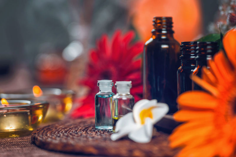 Aromatherapy Aromatherapy Aromatherapy Oil Essential Oils Orange Red Bottles Spa Wellness Relax Glass Therapy Blue Natural Aromatic Brown Care Treatment Healthy Perfume Candles Essence Green Fragnance Organic Health Aroma Fresh Alternative Relaxation Lifestyle Decoration Cosmetic Ingredient Skincare No People Bottle Flower Table Freshness Close-up Orange Color Indoors  Candle