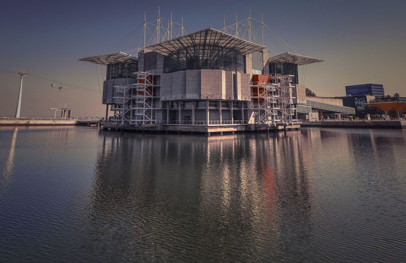 Architecture Building Building Exterior Built Structure City Day Factory Fuel And Power Generation Industry Nature No People Outdoors Pier Reflection Sea Sky Water Waterfront