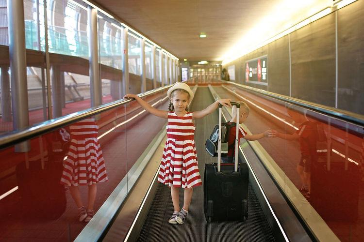 Girl standing on escalator