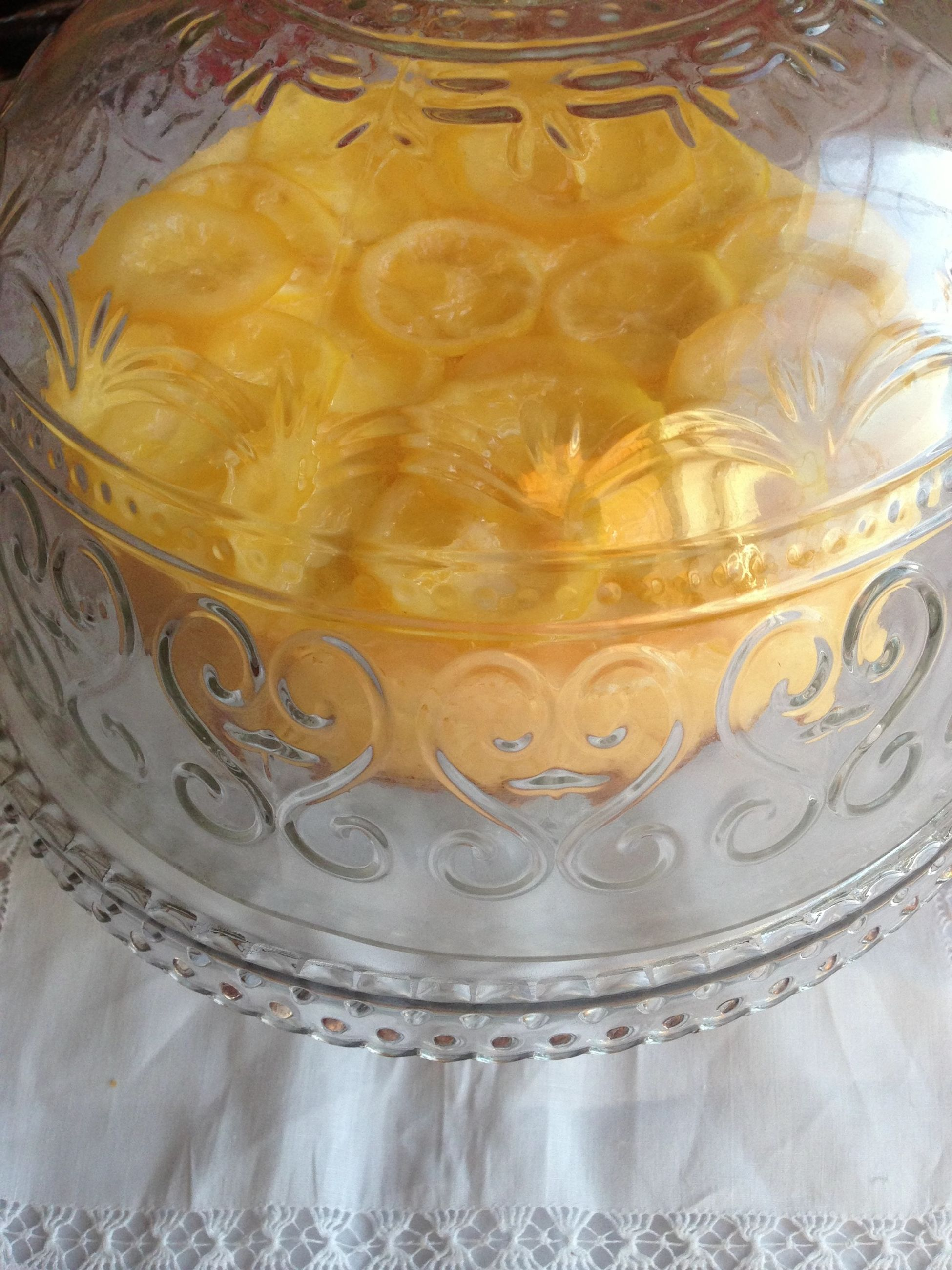 indoors, close-up, art and craft, pattern, art, creativity, design, glass - material, ornate, no people, yellow, gold colored, reflection, water, transparent, decoration, floral pattern, still life, spirituality, circle