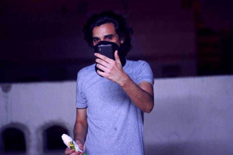 Man Taking Selfie Through Mobile Phone At Night